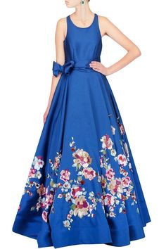 This blue floor length flared gown is in theshades of pink and green textured sequin floral embroidery. This blue gown has a can-can layer underneathand side
