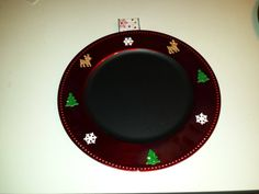 Dollar Store charger plate painted with chalkboard paint, Christmas stickers & ribbon to hang with.