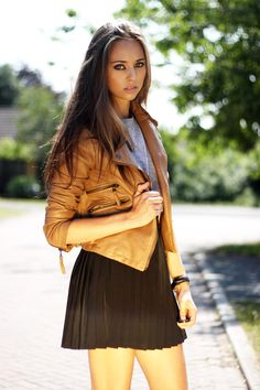 copper leather jacket over black pleated mini.