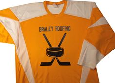 Promote your business with sponsored sports jerseys like this gold and white hockey for braley roofing
