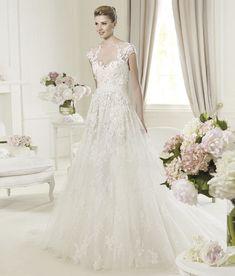 Ellie Saab has some the most beautiful dresses. This 2013 wedding dress Elie Saab is simple but stunning.