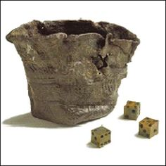 These dice and shaker are from the late 1400s and are made out of bone.  The dice were x-rayed and found to contain droplets of mercury so they always fell the same way!