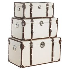 Covered in crisp linen and featuring riveted faux leather accents, these charming trunks are perfect for stowing sheet music by the piano or spare sweaters i...