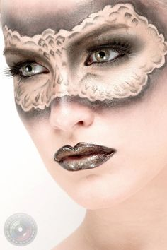 creative makeup. I like the use of negative space to set off the mask.