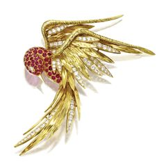 18 KARAT GOLD, RUBY AND DIAMOND BIRD BROOCH, CARTIER, FRANCE, CIRCA 1950. Round diamonds weighing approximately 3.00 carats, signed Cartier, France, numbered 30904.