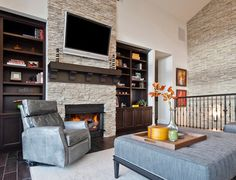 Modern stone fireplace wall ideas stacked stone fireplaces for a warm and modern look of the Stone Fireplace Designs, Stone Fireplace Wall, Stacked Stone Fireplaces, Living Room With Fireplace, Fireplace Shelves, Custom Fireplace, Fireplace Mantels, Bold Living Room, Accent Walls In Living Room