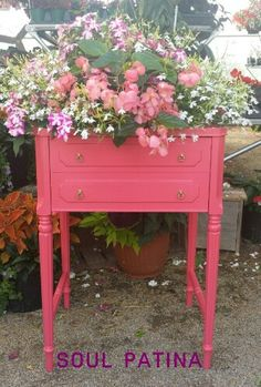 Pink planter made from sewing cabinet. General Finishes milk paint. Done by Soul Patina.