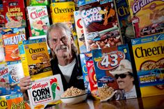 Randy Ricci, collector of over 300 NASCAR-themed cereal boxes, sits among a fraction of his collection.