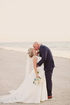 Outdoor Beach Bride and Groom Wedding Portrait, Bride with White and Greenery Bouquet, Groom in Navy Blue Suit | Tampa Bay Wedding