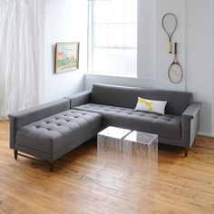 The Harbord Loft Bi-Sectional is a compact sectional with mid-century inspired details and 100% FSC-certified wood. The chaise can be configured on the left, the right, or as standalone seating