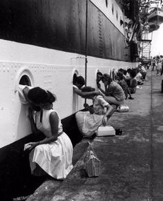 "Italian sailors on the ""Amerigo Vespucci"" saying goodbye to their loved ones, 1963."