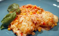 Spanish Chicken & Rice Bake from   1c cream of chicken soup 1c salsa 1/2 c water 1c whole kernel corn 3/4c uncooked long-grain white rice 4 boneless chicken breast 1/2 t chili powder 1/2c shredded cheddar cheese 1c black bean Directions:Mix soup, salsa, water, corn, and beans and rice in 2-quart shallow baking dish.Top with chicken (seasoned with salt and pepper) and sprinkle with chili powder.Cover tightly with casserole lid or foil. Bake at 375°F for 45 minutes or so.Sprinkle with cheese.