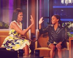 Gabby Douglas gets a high-five from First Lady Michelle Obama during her appearance on The Tonight Show with Jay Leno