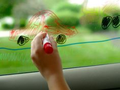 What a fabulous idea!  Give kids a dry erase marker and glove so they can draw and erase to pass time on a road trip.