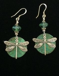 Hand hammered verdigris patina circles are the backdrop for the antique silver dragonfly pieces. Czechoslovakia Picasso crystals reflect the different hues in the patina. Beaded Earrings, Silver Earrings, Beaded Jewelry, Drop Earrings, Unique Jewelry, Silver Ring, Gothic Jewelry, Gemstone Jewelry, Dragonfly Jewelry