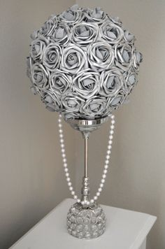 SILVER Flower Ball with draping pearls. You will be absolutely amazed at how real and stunning the roses look. The foam has crisp edges and holds its form over time. Includes draping pearls. These can be used as a beautiful centerpiece or wedding decor without a ribbon. Most weddings