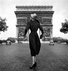 Swedish model Lisa Fonssagrives posing for Schiaparelli clothes, France 1952 by Dennis Stock