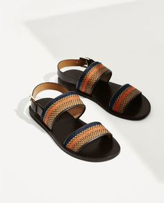 LEATHER SANDALS WITH BROWN AND ORANGE STRAPS