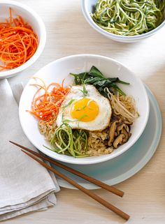 "A traditional Korean rice dish, bibimbap means ""mixed rice"" and typically includes sautéed veggies, fried egg or meat and chili pepper paste."