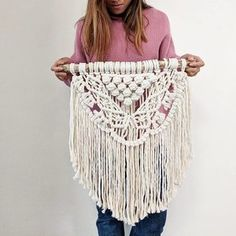 This macrame wall hanging was hand-made by Hanifah Tohir in Sydney, Australia and is made to order. It is perfect to hang in a small room such as the bedroom or bathroom. A single strand cotton rope is used to create this soft look and will complete your cozy room.  Each piece is made with a unique stick and will slightly differ from the image shown.   Measurements: Length: Approx. 50 cm Height: Approx. 60 cm (from top of stick)  Please allow 2 weeks for production.