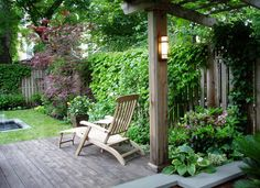 grape arbor provides shade and frames the view © 2012 Green Room Landscape Designs, LLC