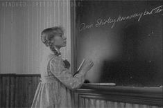 Anne fixing her name on the board [gif].