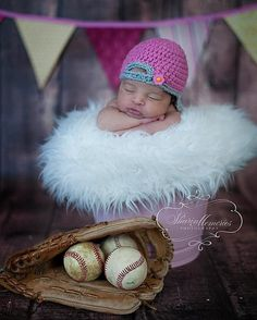 newborn photo - obviously without the baseball stuff for us.