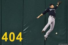 Seattle Mariners fielder Michael Saunders comes up short at the wall against Tampa Bay Rays' Matt Joyce during the first innings of their MLB American League game in Florida.