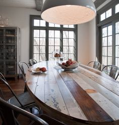 Painted gray trim, gray over-sized enamel pendant, tolix chairs, THAT table!!