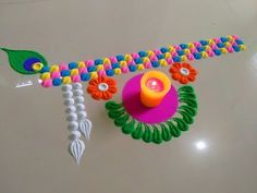 Janmashtami special very easy rangoli design - ArtsyCraftsyDad Very Easy Rangoli Designs, Rangoli Simple, Rangoli Designs Latest, Rangoli Designs Flower, Free Hand Rangoli Design, Rangoli Border Designs, Small Rangoli Design, Colorful Rangoli Designs, Flower Rangoli