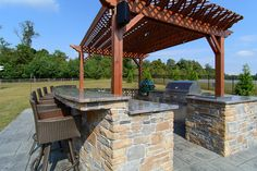 Backyard Retreat in Bowie, MD. Project by The Sharper Cut Landscapes. Photo by Matchbook Productions - outdoor kitchen using EP Henry Ledgestone veneer stone; granite counter top; custom presure treated wood pergola with lighting and speakers; big green egg; built in grill; great furniture selection for the space; great entertainment space    Flickr - Photo Sharing! www.SharperCut.com