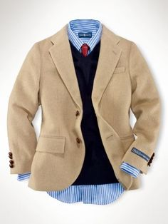 Camel blazer, navy sweater, blue shirt, red tie.