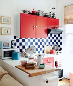 Besides being the symbolic color palette of America's Independence Day, I think red white and blue are pretty dynamic color companions when it comes to design. While blue is one of my favorite colors to use in interiors, red may be the most energetic hue in the bunch, and is often used for that very reason. I love the way red can instantly bring life to shades of blue, or warm up a white room (like the first space in the slideshow). For these reasons, I'll definitely be looking for red…