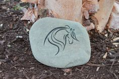 "Stone Engraving, Engraved natural Stone Horse.The stones are deeply engraved in a natural gray river stone. Stone colors vary. The stones are approx.6 x 5"".  All of the stones are sandblasted and handmade"