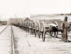 African American soldier guarding a row of 12-pdrs. at City Point Virginia.