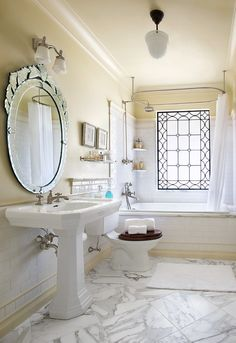 Wall Mounted Shower Curtain Rod, Mirror, Marble Floors, Wooden Toilet Seat, and Window:Panageries Design| Photo Wayne Culpepper