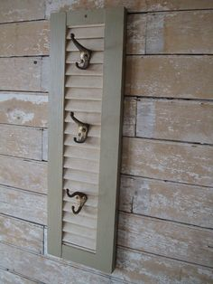 Wooden Vintage Shutter Cap or Jewlery Rack Antique Hooks. via Etsy.
