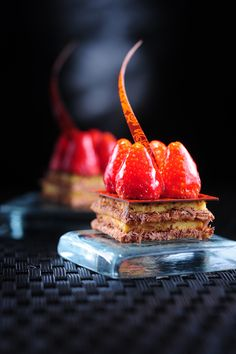 Mille Feuilles Layers of caramelized puff pastry filled with vanilla creme mousseline,topped with garden berries|THOMAS TRILLION