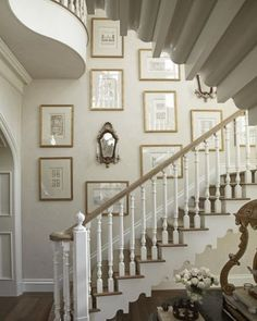 Styling the Staircase: Architectural engravings in similar gold frames make a statement.