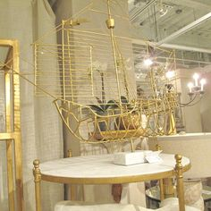 Santa Maria Caravella - Clayton Gray Home | gold metal boat on a marble stand - nautical decor