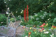 Timber bed with red bamboo garden poles Bamboo Garden, Garden Beds, Garden Art, Timber Beds, Turtle Rock, Garden Poles, Tours, Outdoor Structures, Gardens