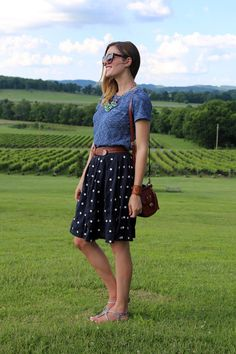 Love the knee length skirt and casual shirt with a belt and flats.