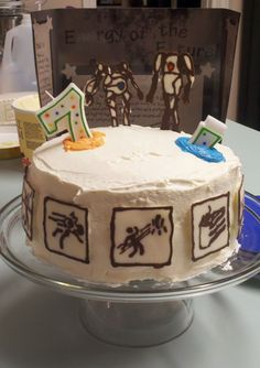Portal 2 cake I made for my son's birthday.  I hate fondant, so this is buttercream with decorations made from melted chocolate.