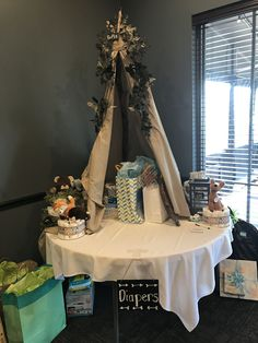 DIY tipi, woodland theme baby shower, gift tent and diaper raffle table #diypartydecorationsboho