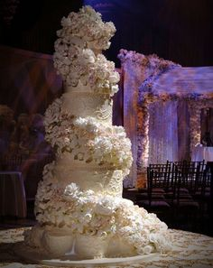 This all-white wedding cake by Sylvia Weinstock is a gorgeous confection of various sugar flowers and delicious buttercream. Description from indulgy.com. I searched for this on bing.com/images