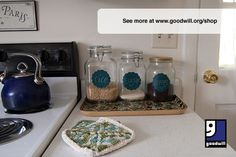 Organize your kitchen counter with jars from Goodwill using tips from blogger @Julia Berry