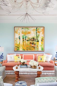This pool house living room sports sherbert-colored hues and feminine flourishes. #livingrooms #homedecor #southernliving
