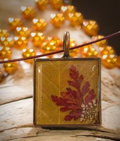 Autumn leaves in resin; The Blue Brick jewelry.
