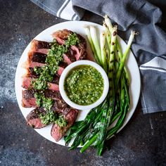 Cooking steak is hard. Cooking Sous Vide Steak with Chimichurri Sauce and Grilled Scallions couldn't be easier! Sous-vide cooking provides consistently great results EVERY SINGLE TIME! Steak With Chimichurri Sauce, Beef Recipes, Cooking Recipes, Recipies, Roasted Pineapple, Sous Vide Cooking, Cooking Steak, Western Food, How To Cook Steak