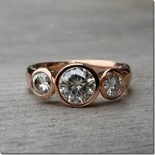 Pinned Image This is recycled rose-gold and some stone called Moissanite. It's a fabricated carbonate stone modeled after some meteorite. but it's shiny and pretty. Bridal Rings, Wedding Rings, Gold Wedding, Bridal Jewelry, Dream Wedding, Dress Rings, Rose Gold Engagement Ring, Wedding Engagement, Beautiful Rings